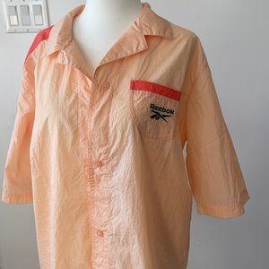 Reebok pink shirt (small)